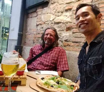 Thomas from Germany and Felix Wong enjoying pizza and beer for dinner in Santander.