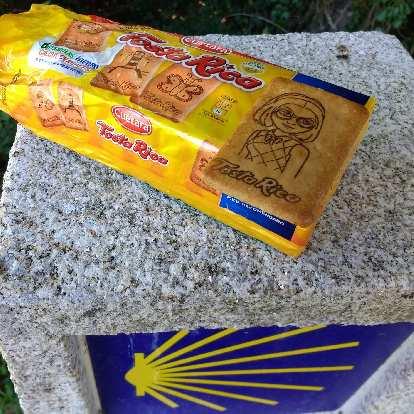 Tosta Rica biscuits with a Camino de Santiago kilometer marker.