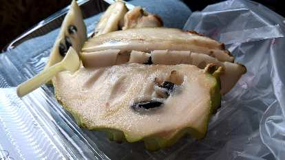 Fruit known as the sugar-apple (Chinese: 釋迦, or Shìjiā).  Its black seeds are toxic.