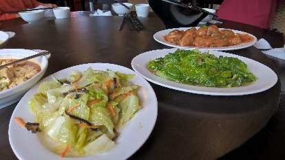 Cooked nappa cabbage, cooked lettuce and chicken.