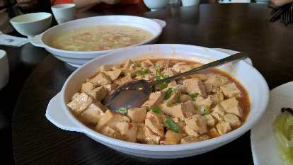 Egg drop soup and a tofu dish.