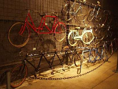 Old multi-person bicycles.