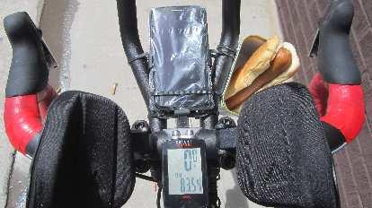 handlebars, red handlebar tape, aerobars, phone, cycle computer, hot dog