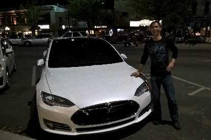 Felix Wong, white Tesla Model S