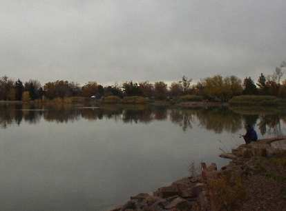 A lone fisherman at one of the umpteen lakes in Fort Collins.