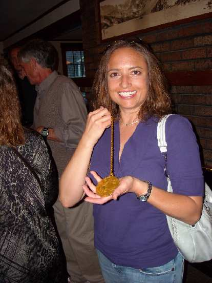 Raquel with Frank's gold medal from the 1972 Olympic marathon in Berlin.