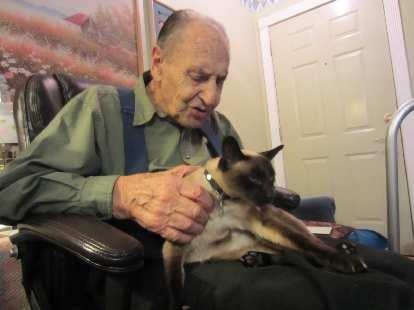 Frank with his cat Mushka.