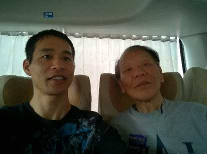 Felix and his dad on the tour bus in Taiwan.