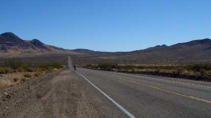 [Mile ~127, 3:36 p.m.] On a nice decent after Johannesburg and Mountain Section 3.  Heading towards Trona.