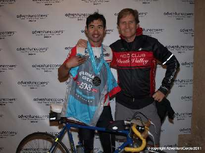 Felix Wong with Chris Kostman, founder of AventureCorps. Finishers got a blue finishing jersey.
