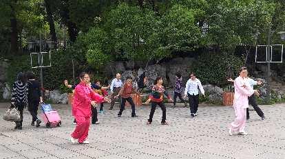 Local Taiwanese doing tai chi at Zuohai Park in Fuzhou, China.