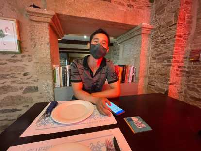 Felix looking at the online menu at the Casa dos Xacobes in Santiago de Compostela.