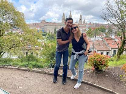 Felix and Andrea with the Cathedral of Santiago de Compostela in the background.