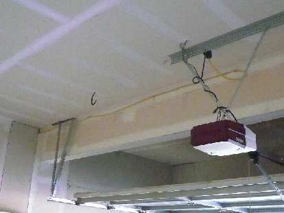 [Before] This yellow wire provided power to an outlet on a side wall, but was left exposed!  I ran it through the ceiling.