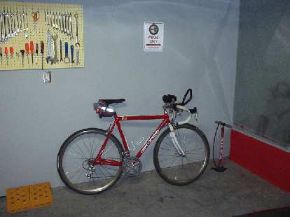 "The Italian corner, with the Silca tire pump, Campagnolo-laden Cannondale, and an ""Alfa Romeo Parking Only"" sign."