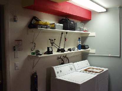 More useful tools on display, including my 1960s Sears dwell tachometer, timing gun, SU carburetor synchronizer, Minoura truing stand, battery charger, propane torch...