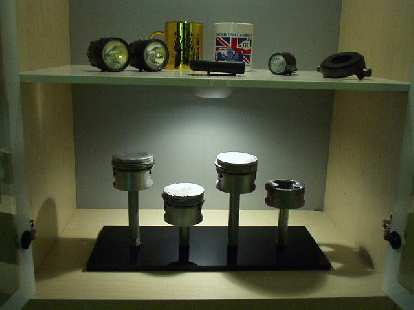 The Garage Mahal theme extends into rest of the house with Goldie's pistons (after they blew up) on display.  I may post some pics of my newly-painted living room, one day...