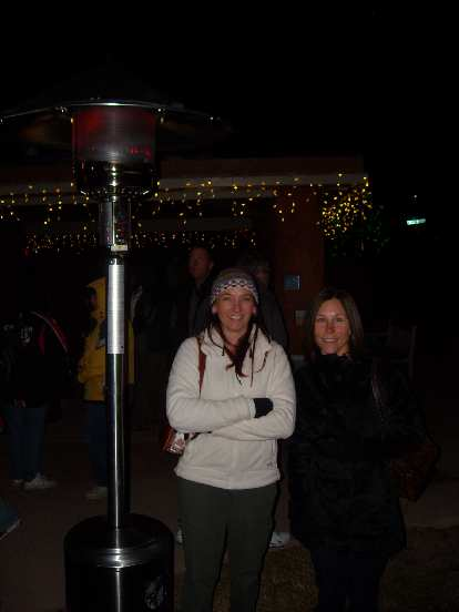 Tori and Lisa keeping their heads warm by the heat lamp.