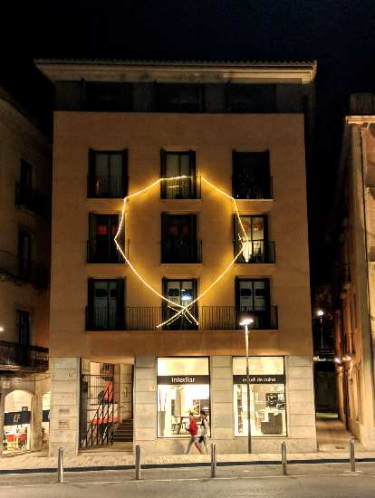 The yellow ribbon symbolizes Catalonians' support for politicians imprisoned by Spain for holding a referendum for independence in October 2017.