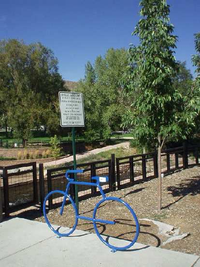 Another bike rack shaped as a bicycle in front of a park.  I love these!