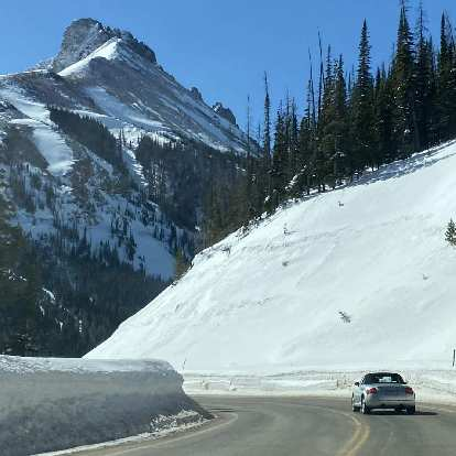 My silver 2001 Audi TT Roadster Quattro surrounded by snow walls near the top of Cameron Pass in the Poudre Canyon.