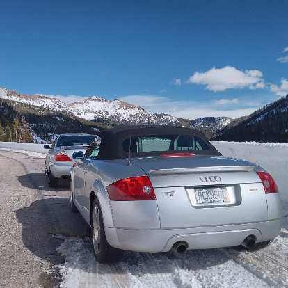 Silver Acura CL and Audi TT Roadster Quattro a couple miles west of Cameron Pass in the Poudre Canyon.