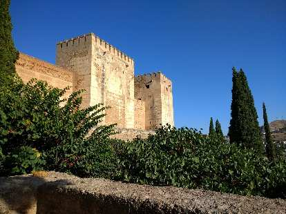 The stone castle tower walls of Alcazaba at the Alhambra in Granada, Spain.