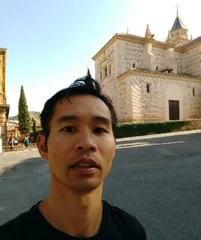 Felix Wong in front of Palacio Carlos V at the Alhambra.