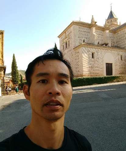 Felix Wong in front of Palacio Carlos V at the Alhambra.