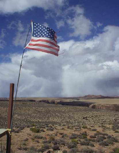 An American flag flies high above the canyon that Teddy Roosevelt felt every American must see before he dies.
