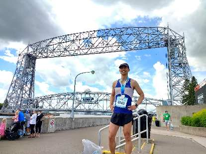 Felix Wong with the Aerial Lift Bridge in Duluth, MN after the 2017 Grandma's Marathon.