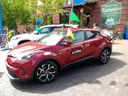A red 2018 Toyota C-HR on display in Duluth, MN at Grandma's Marathon. Toyota has been taking more risks with the styling of its vehicles lately.