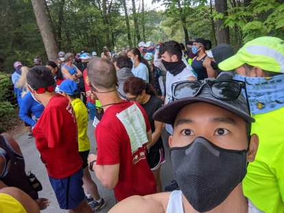 runners wearing facemasks at the start of the Granite State Marathon