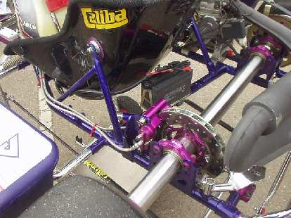 This offset disc brake (in the rear) is the only brake on the car.  Some go-karts have brakes on all four corners.
