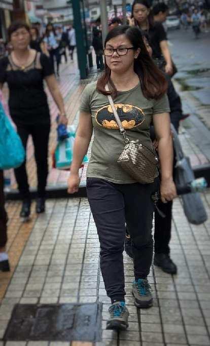 A woman in Guangzhou, China, wearing a Batman shirt.