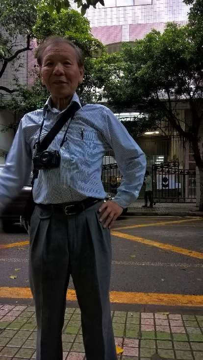 My dad in front of his old elementary school off Renmin N Rd. (near Jinghui Rd.) in Guangzhou, China.
