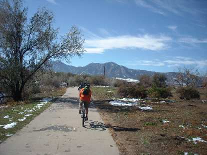 Riding along the recreation trail towards the Flatirons.
