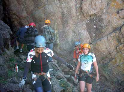 Jen and Kelly having safely rappelled down.