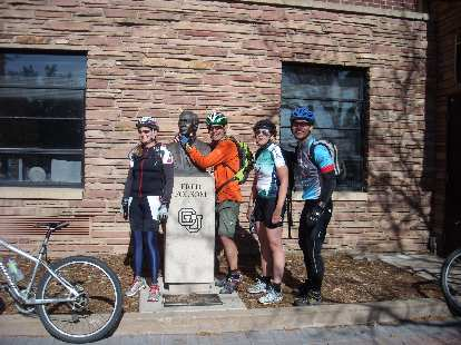Jen, Eddie, Kelly and Felix Wong with the Fred Folsom statue in boulder.