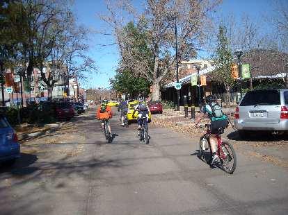Biking towards the Pearl Street Mall.