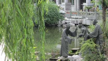 Statues in the water near the Leifeng Tower.