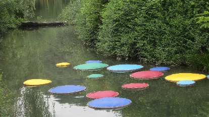 Colorful disks in the water in Hangzhou.