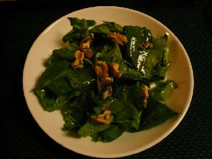 One of my all-time favorite salads: spinach with walnuts and a raspberry vinaigrette dressing.  I even whip this up sometimes when I have company.