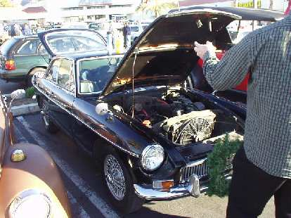 The car tour which consisted of at least 100 cars was supposed to be for pre-1931 horseless carriages only.  However, some exceptions were made for a Volkswagen Bus, NSU Prinz 30, and this MGB GT.