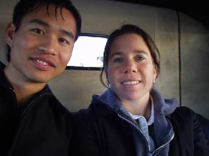 Here's Felix Wong and Sharon together in the backseat of the Star.  Personally I thought it was pretty romantic to get to ride in a horseless carriage through much of the tree-lined Rose Parade route.