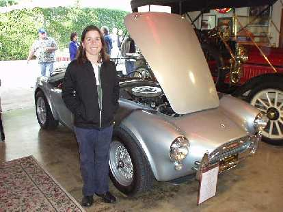 Wait a minute, the body panels aren't fiberglass...  It turned out that this Shelby Cobra was authentic (not a kit), which I got Sharon to pose with.
