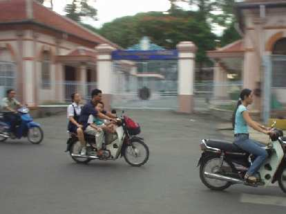 Entire families (with kid in front) rode motorbikes!