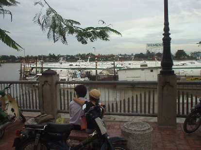 Two lovebirds enjoy the view by the Saigon River.