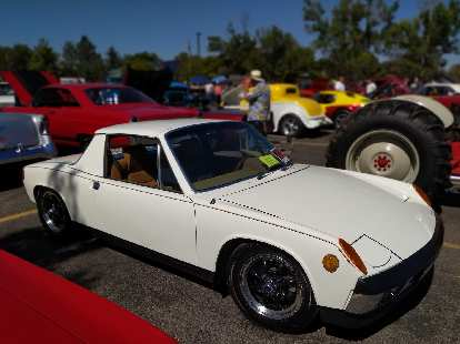 A white Porsche 914, one of the nicest I've seen. It had a custom Colorado European-style license plate (with the same license numbers as the rear, legal American plate).