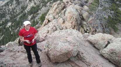 Maureen wearing red shirt on Horsetooth Rock